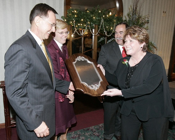 JOHN F. ELBERS II | ROCKFORD REGISTER STAR Carpenter?s Place interim executive director Kay Larrick and Al Barsema accept the 2007 Excelsior Award Thursday at Cliffbreakers in Rockford. Cathy Barsema and Rockford Register Star publisher Fritz Jacobi joined the presentation.